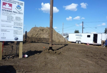 Screw piles being installed